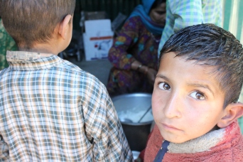 Kids in Jeddra kohl lining up for the daily mid-meal provided freely as stated by the Right to Education Act.